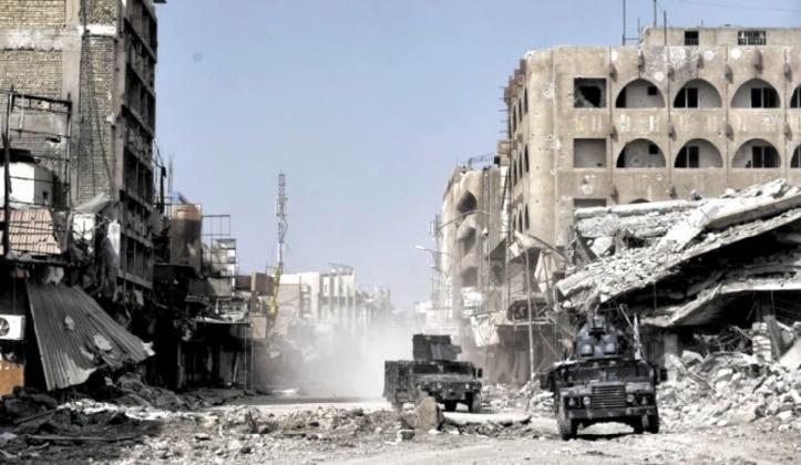 """La coalition promet d'éradiquer la """"menace planétaire"""" de l'EI et son chef"""