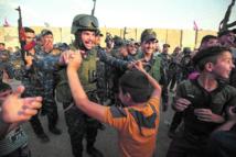 Les forces irakiennes célèbrent la libération de Moussoul
