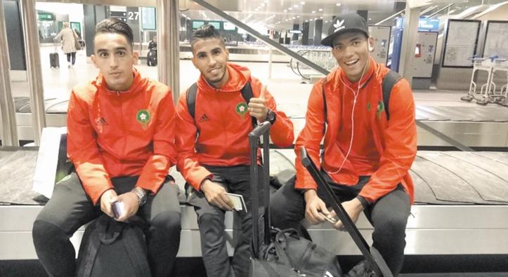 Boulehroud, Ounajem et Taghnaouti lors de l'arrivée de l'EN à l'aéroport de Zurich   Ph. frmf.ma