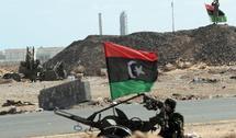 L'opposition libyenne exige le départ de Mouammar Kadhafi :  Soutien croissant à l'établissement d'une zone d'exclusion aérienne