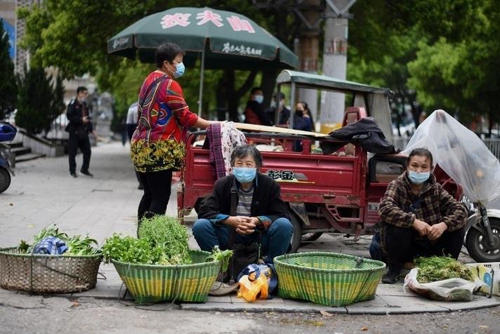 Même sans bouclage, la peur demeure dans le berceau du virus en Chine