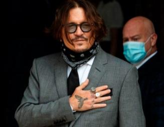 Les employés de Johnny Depp assurent qu'il n'était pas violent