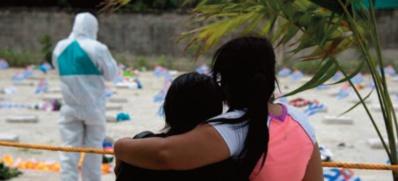 Plus de 1,2 million de morts, nouvelles restrictions contestées en Europe