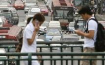 Les téléphones portables au secours financier des migrants d'Asie