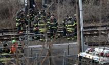 Recherche des causes du déraillement d'un train à New York
