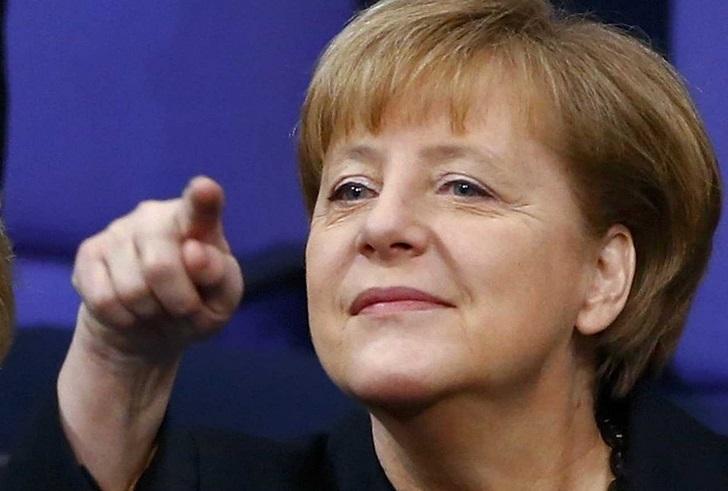 Merkel entame son troisième mandat par une visite à Paris