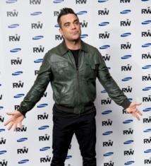 Ces célébrités qui ont pris du muscle : Robbie Williams