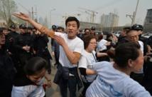 Manifestation à Pékin de familles des passagers du Boeing malaisien