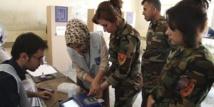 Les Irakiens défient les violences pour élire leurs députés