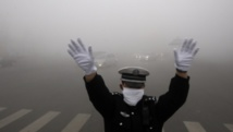 """Première """"alerte rouge"""" à la pollution à Pékin"""
