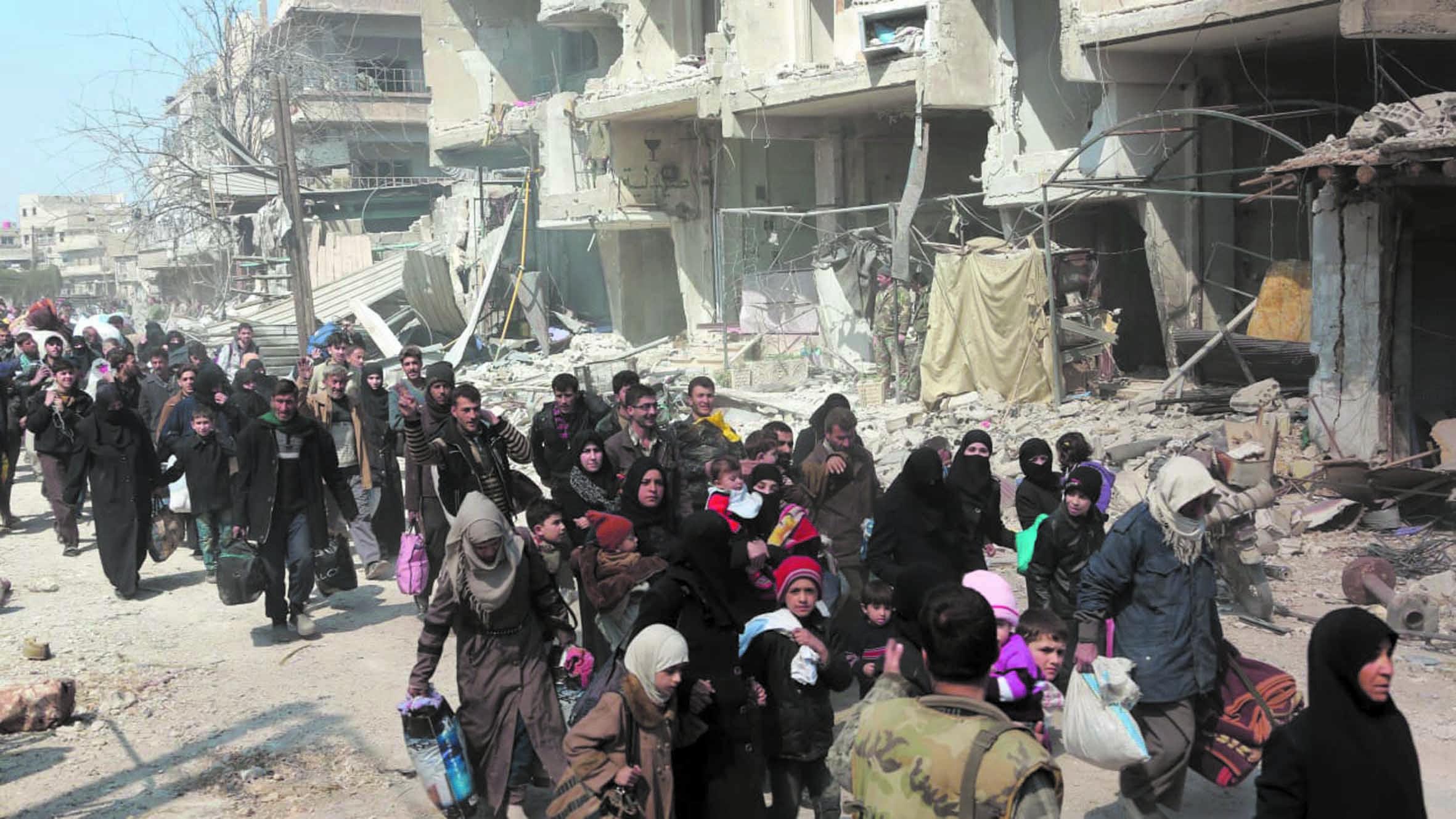 Exode massif de civils syriens de Ghouta et d'Afrin