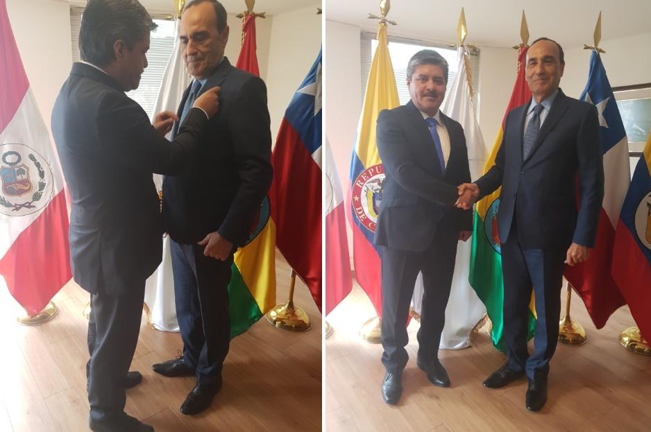 Hugo Quiroz Vallejo décorant Habib El Malki et Poignée de main entre les présidents de la Chambre  des représentants et du Parlement andin.