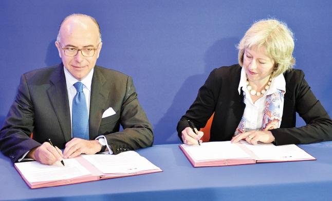 Paris et Londres signent un accord pour faire face à l'afflux massif des migrants à Calais