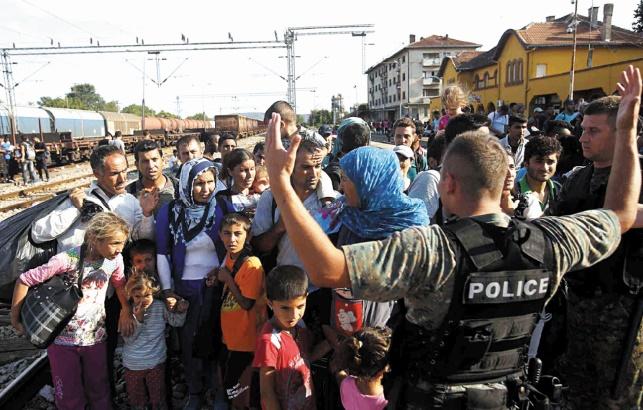 Berlin menace de passer par un vote de l'UE à la majorité pour la répartition des migrants